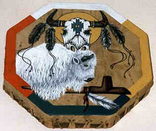 Octagonal drum painted.  The border painted with colors of the Four Directions:  East ochre, South black-blue, West red and North white.  From the left the White Buffalo leans over the Sacred Pipe  decorated with a white feather attached to the pipe with a  leather string. The right horn of the buffalo in the center  of the drum. At the top a Buffalo Scull sun shield. Two  feathers, decorated with strings attached to each buffalo horn.  The strings tangling down over the white buffalo and into the  open space West. The roots of the horns decorated with rings.  A weaving motive adorns the forehead of the buffalo scull.
