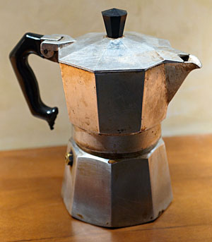 The Italian Alfonso Bialetti, 1888 - 1970, invented in 1933 the Mocha Express. The Mocha Express looks like an octagonal aluminum jug with lid. The lower part is filled up to the valve-level with water. The middle part, which gets filled with ground coffee, fits therein. The upper part, which receives the coffee, is screwed onto the lower part. The jug has a handle and the lid a button, both made of black plastic.  Source: Imm808 2007 commons.wikimedia