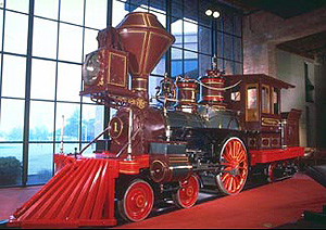 The red painted pilot, 'cattle- or cowcatcher',   at the front of probably a pioneer steam locomotive  pushed obstructive cattle off the rails.  Built in 1863. Source: www.parks.ca.gov; Magnus Manske 2008 commons.wikimedia